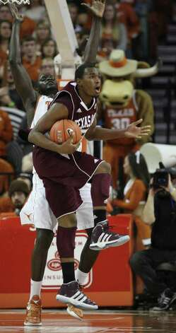 Texas A&M guard Elston Turner reacts to a travel call as University of Texas forward Alexis Wangmene defends during the first half at the Frank Erwin Center in Austin, Texas, Wednesday, Jan. 11, 2012. JERRY LARA/glara@express-news.net Photo: JERRY LARA, Express-News / SAN ANTONIO EXPRESS-NEWS