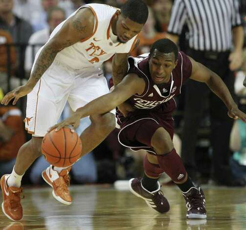 University of Texas guard Julien Lewis, left, and Texas A&M gaurd Elston Turner scramble for the ball during the first half at the Frank Erwin Center in Austin, Texas, Wednesday, Jan. 11, 2012. JERRY LARA/glara@express-news.net Photo: JERRY LARA, Express-News / SAN ANTONIO EXPRESS-NEWS