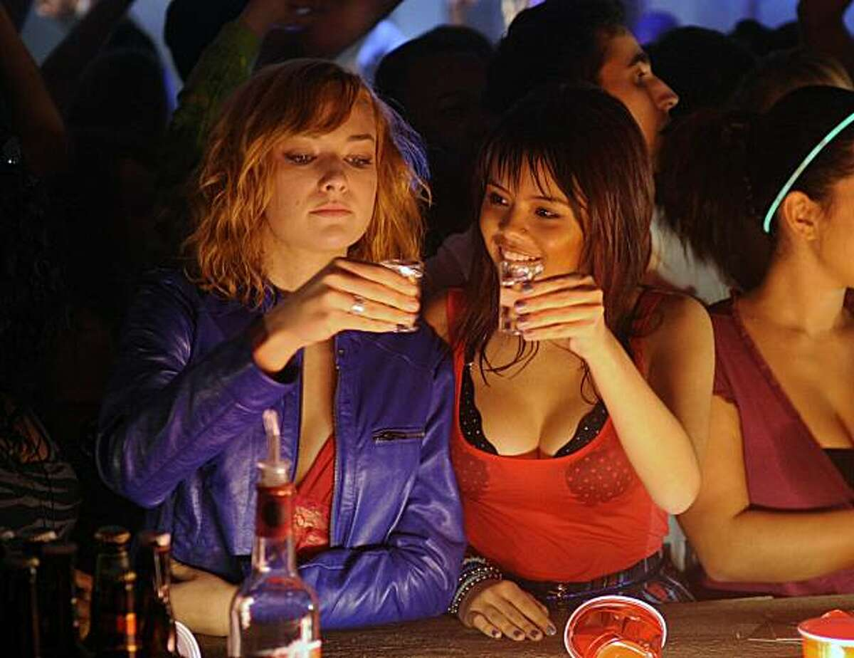 In this publicity image released by MTV, Rachel Thevenard portrays Michelle, left, and Camille Cresencia-Mills portrays Daisy in a scene from the adolescent drama