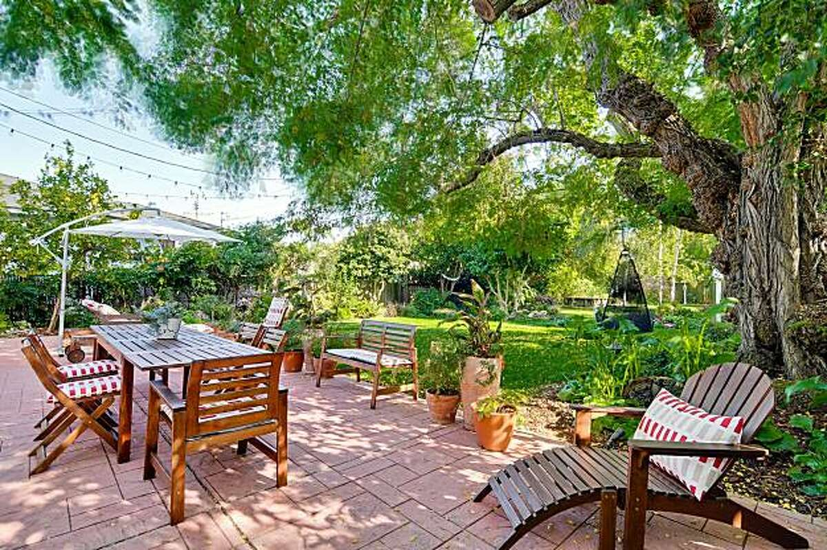 The backyard includes a large brick patio.