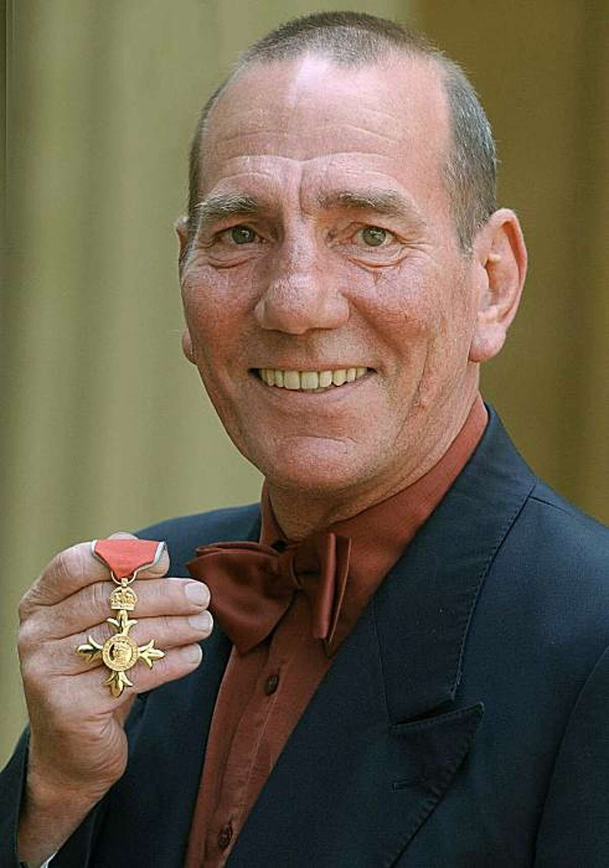 A Wednesday, June 9, 2004 photo from files showing British actor Peter Postlethwaite displaying his Order of the British Empire or OBE, shortly after the presentation at Buckingham Palace in London. Britain's Press Association is reporting Monday,Jan. 3, 2011 that decorated film actor Pete Postlethwaite has died at the age of 64. It quotes longtime friend Andrew Richardson as saying Monday that Postlethwaite died in hospital in Shropshire, central England, after a long illness. Richardson said Postlethwaite died Sunday. He had been receiving treatment for cancer.