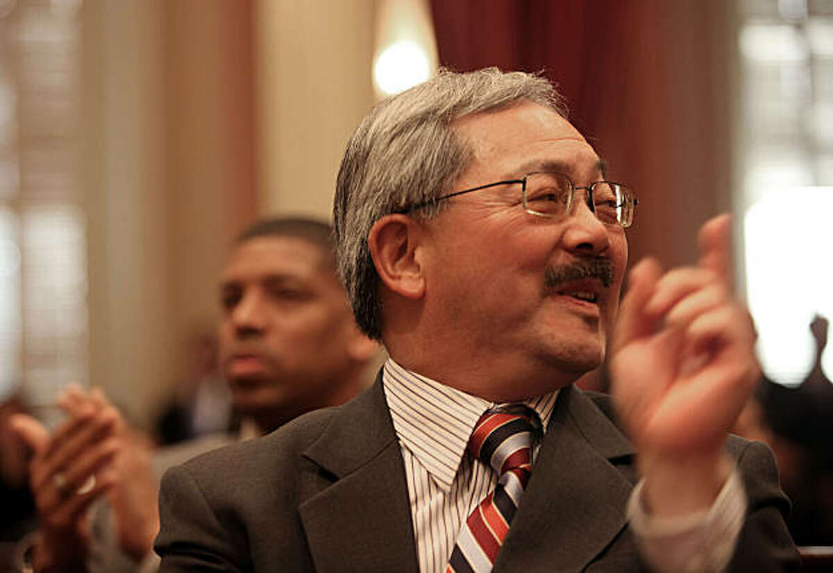 Ed Lee (front), San Francisco interim mayor, and mayor Kevin Johnson (left) watch as Gavin Newsom gets sworn in as lieutenant governor by his father, Hon. Judge William Newsom (left) at the state capitol in Sacramento, Calif., on Monday, January 10, 2011.