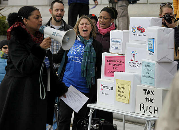 "Protesters built a tower of program names that could help the budget deficit including tax breaks for corporations and commercial property tax loopholes. Dozens of concerned seniors, disabled persons and mothers rallied in front of the California state building on McAllister Street in San Francisco, Calif., demanding that Governor Brown look at ""all revenue options"" for necessary budget cuts Monday January 10, 2011. Photo: Brant Ward, The Chronicle"