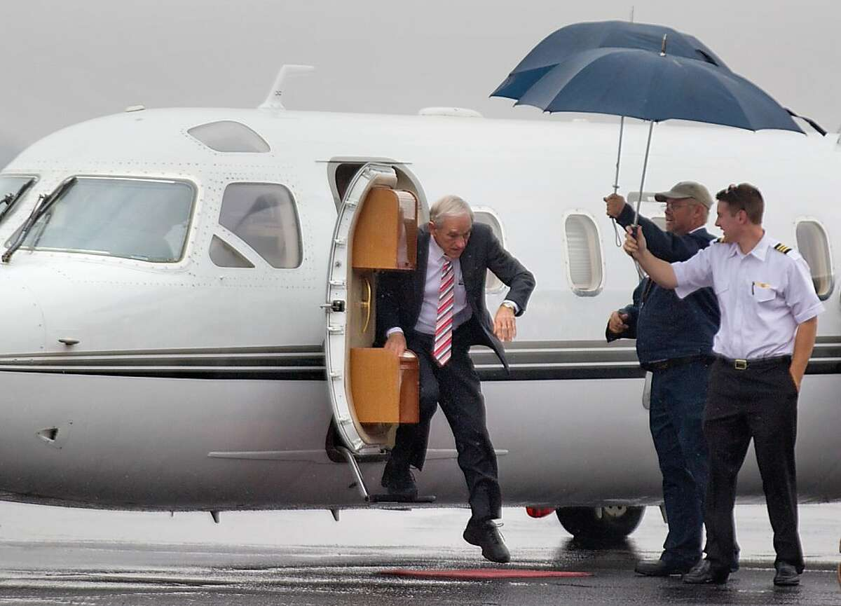 Republican presidential candidate, Rep. Ron Paul, R-Texas steps from a airplane as he arrives for a campaign stop, Wednesday, Jan. 11, 2012, in West Columbia, S.C.