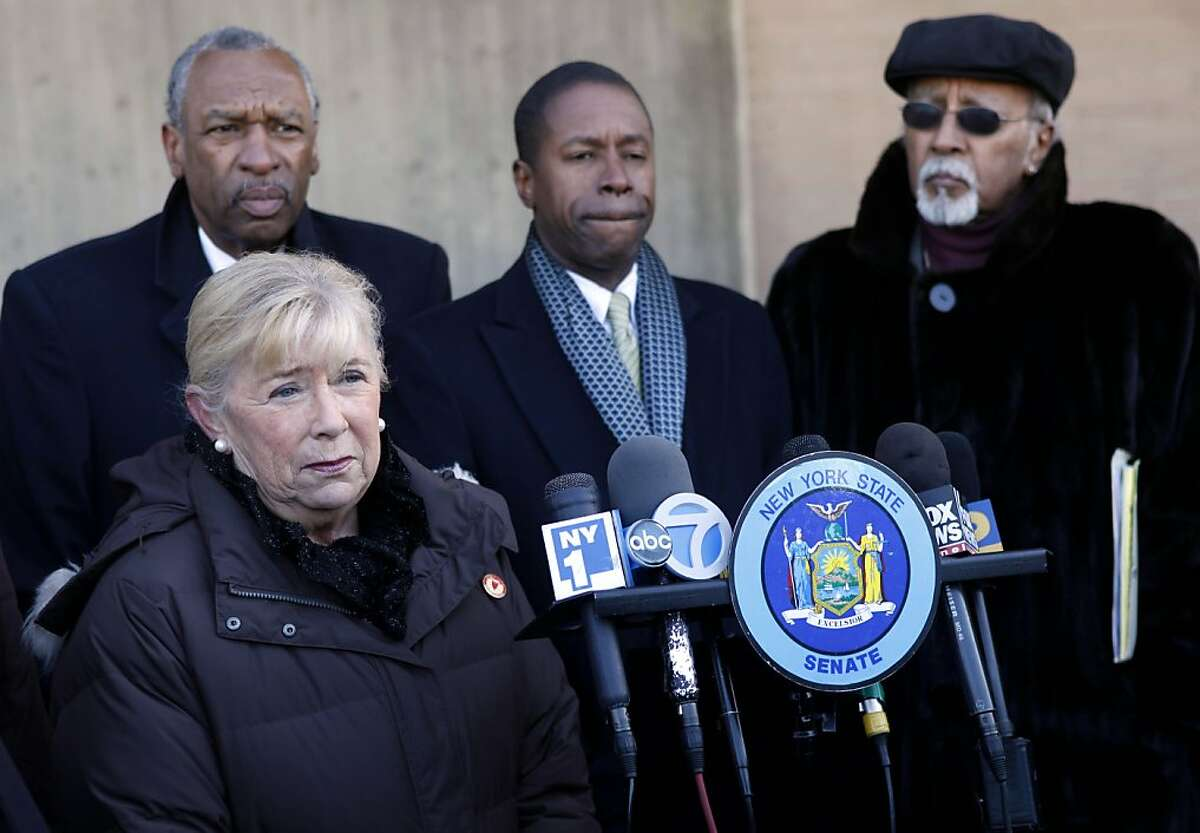 Surrounded by local leaders, Rep. Carolyn McCarthy, D-N.Y., takes questions from the media about the shooting of a congresswoman in Arizona during a news conference in New York, Monday, Jan. 10, 2011.