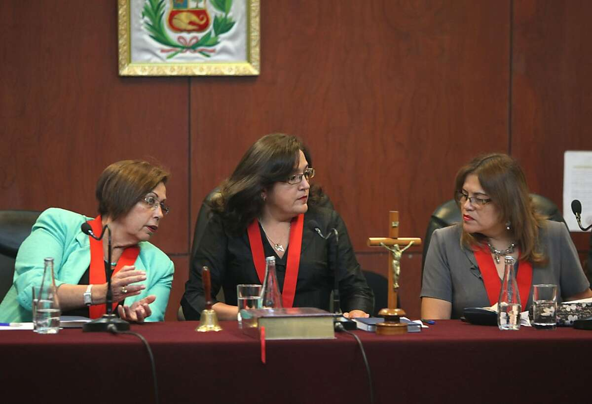 Judges Victoria Montoya, center, Otilia Vargas, left, and Pilar Carbonel speak before the continuation of Joran van der Sloot's trial at San Pedro prison in Lima, Peru, Wednesday Jan. 11, 2012. Joran van der Sloot pleaded guilty on Wednesday to the 2010 murder of a 21-year-old Peruvian woman he met at a Lima casino who was killed five years to the day of the unsolved disappearance in Aruba of an American teen in which he remains the main suspect.