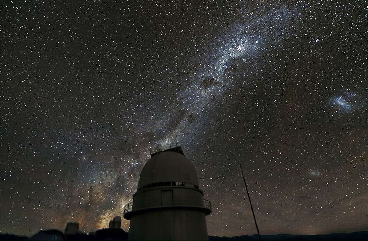 This 2011 handout photo provided by the European Southern Observatory, shows the Milky Way above the La Silla Observatory in Chile. The more distant telescope in the photo was used to survey planets in our galaxy using a time consuming technique. The results indicate that on average there are 1.6 larger planets per star in our solar system, but that's mostly looking at planets that are far from their star. Other methods look more on close-in planets and putting those techniques together, astronomers think that means stars in the Milky Way probably average well over two planets. (AP Photo/Zdenek Bardon/ProjectSoft, European Souther Observatory)