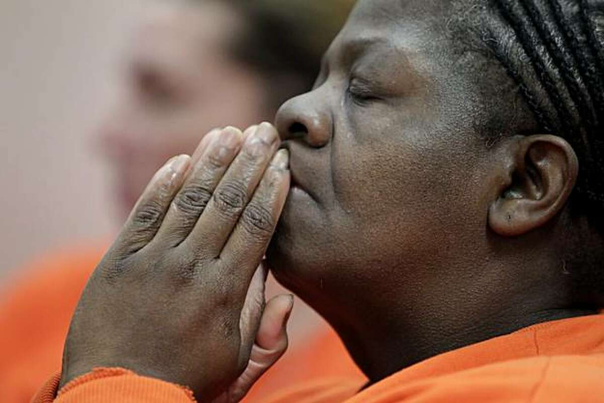 Elsie Bryant, 51, reacts as she hears Reverend Carolyn Dyson from the California Pacific Medical Center tell the group of women inmates that she had been diagnosed with breast cancer, Tuesday Dec. 28, 2010, in San Francisco, Calif. Officials from the California Pacific Medical Center introduced a new program that is going to provide women inmates at the San Francisco County Jail, upon release free mammograms and follow-up care.