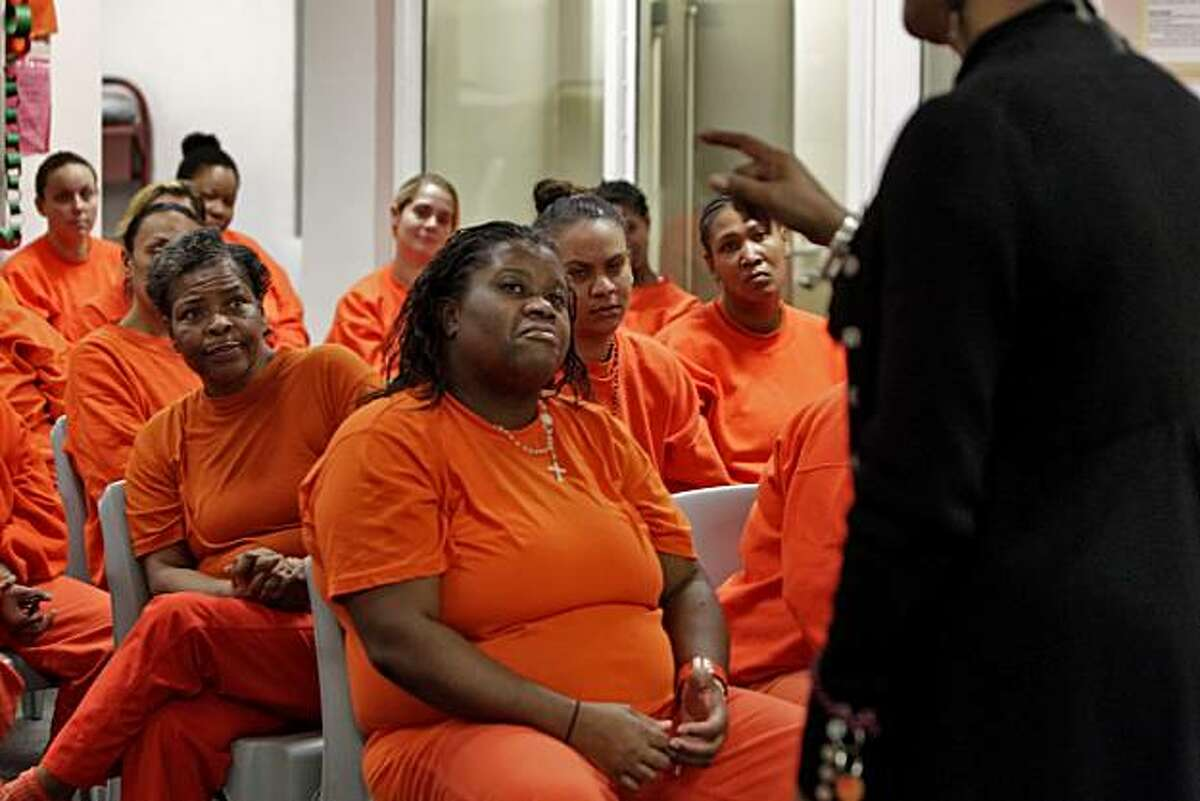 Sandra Hawthorne, left and Elsie Hodge, front, listen as Cheryl Dawson M.Div speak to the inmates at the San Francisco County Jail, about how mammograms can detect breast cancer, Tuesday Dec. 28, 2010, in San Francisco, Calif. California Pacific Medical Center has started a program that gives women inmates upon release free mammograms and follow-up care.