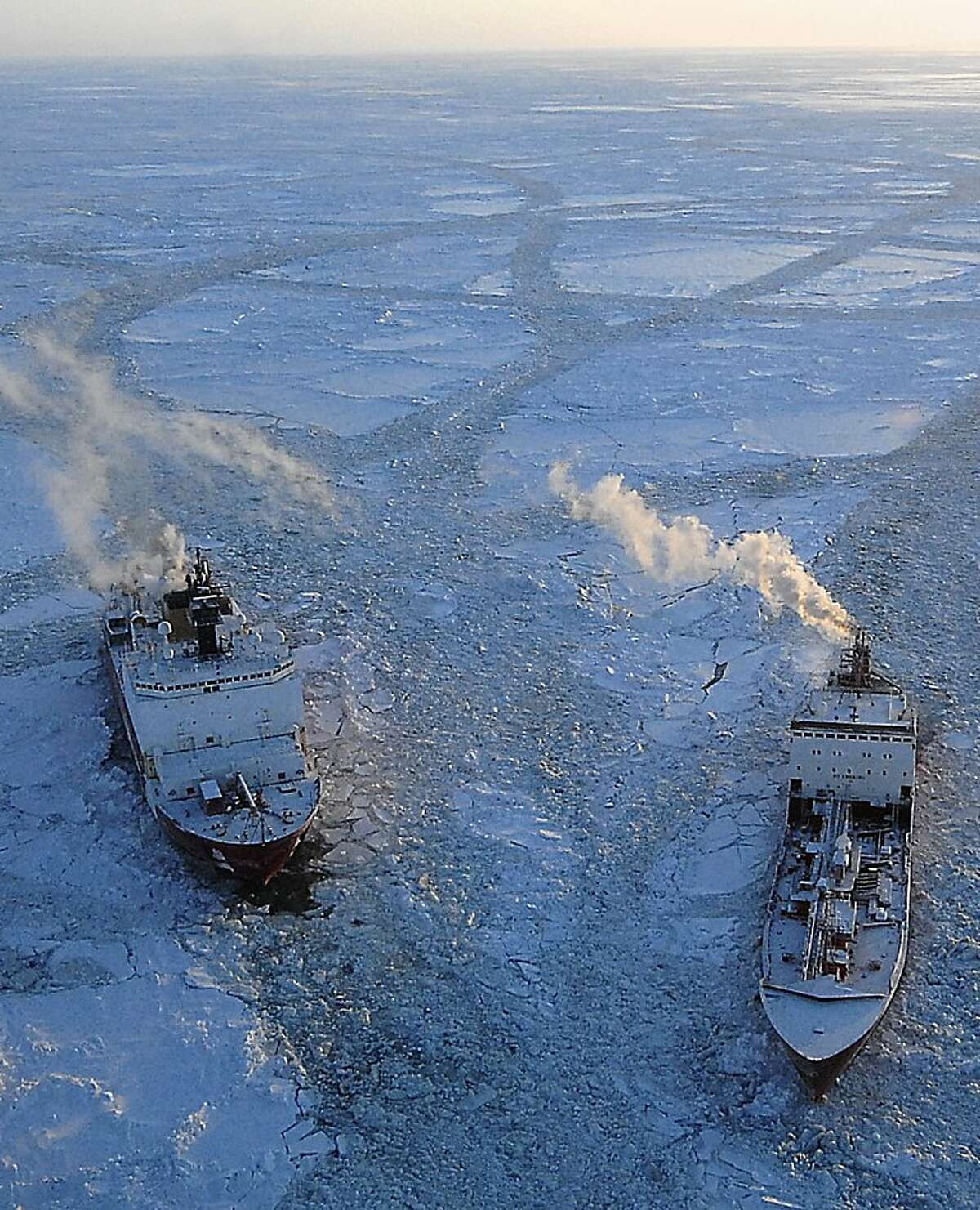 In this photo provided by the US Coast Guard, the cutter Healy, left, breaks ice around the Russian tanker Renda in the Bering Sea Tuesday, Jan. 10, 2012, 97 miles south of Nome, Alaska. The two vessels departed Dutch Harbor for Nome on Jan. 3, 2012, to deliver more than 1.3 million gallons of petroleum products. (AP Photo/U.S. Coast Guard/Petty Officer 1st Class Sara Francis)
