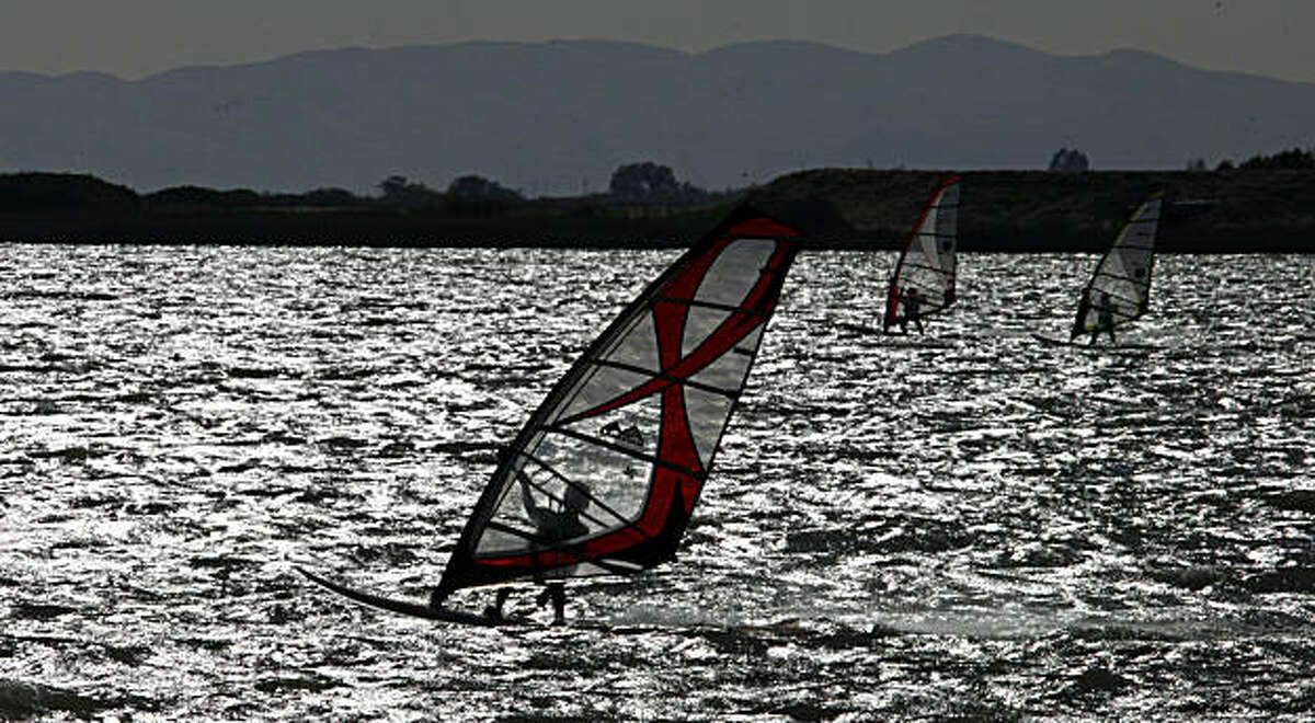 Wind surfers glide across the mouth of the Sacramento River off Sherman Island in the Delta, which has more than two hundred miles of waterways Thursday June 24, 2010. Levee collapses from the Sacramento-San Joaquin Rivers are a constant threaten to towns and farms built next to the levee system, as well as recreation, The possible introduction of salt water to the system is viewed negatively by most that rely on the levees. Thursday June 24, 2010.