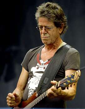 Lou Reed performs at the Lollapalooza  music festival Sunday, August 9, 2009, in Chicago. (AP Photo/John Smierciak) Photo: JOHN SMIERCIAK, AP