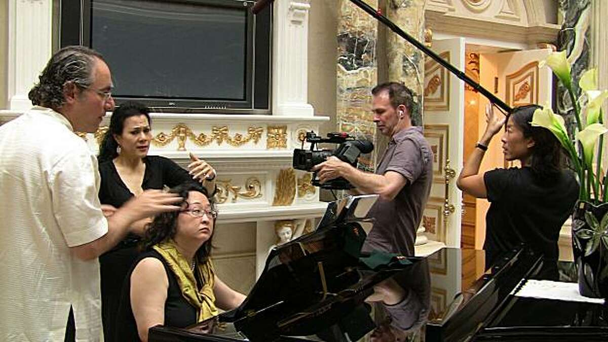 Documentary filmmakers David Petersen and Monica Lam capture a rehearsal with composer Stewart Wallace and opera singer Ning Liang for the film,