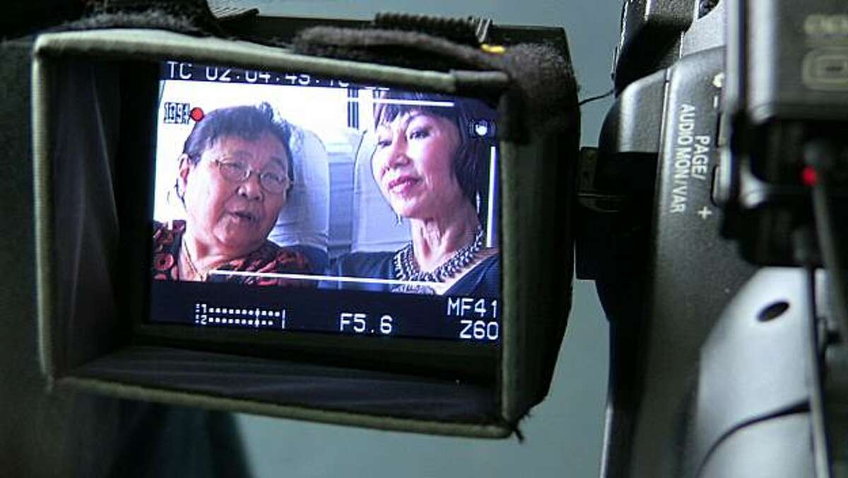 Author Amy Tan shown with her half-sister Yuhang Wong through the viewfinder during the making of the documentary,