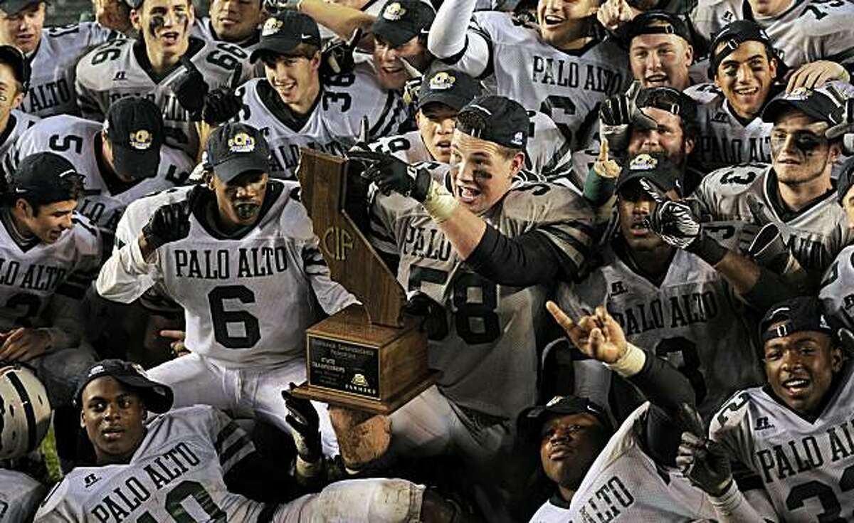Members of the Palo Alto team celebrate with their trophy after defeating Centennial in their CIF Division l high school football championship game, Friday, Dec. 17, 2010, in Carson, Calif.