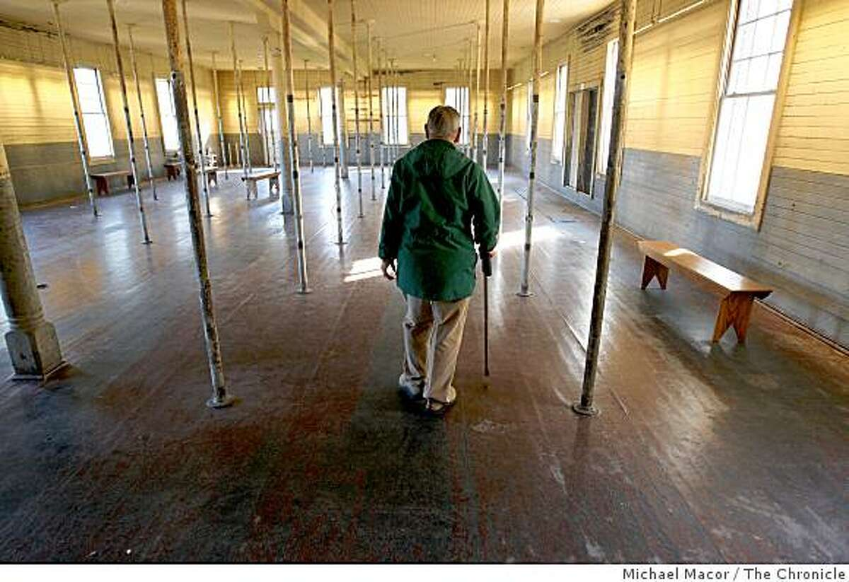 Dale Ching, 87, walks through the first floor barracks room, of the Angel Island immigration Center, in TIburon, Calif., on Tuesday Dec. 9, 2008. Ching was detained for three months at Angel Island Immigration Center in 1937, waiting to be granted entry into the United States when he was 16 year old.