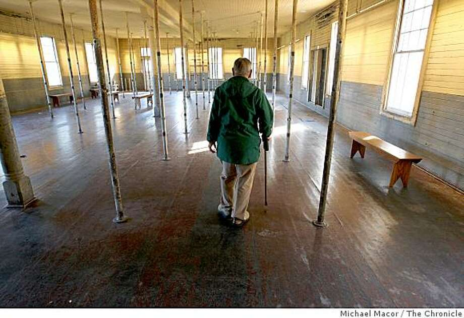 Dale Ching, 87, walks through the first floor barracks room, of the Angel Island immigration Center, in TIburon, Calif., on Tuesday Dec. 9, 2008.  Ching was detained for three months at Angel Island Immigration Center in 1937, waiting to be granted entry into the United States when he was 16 year old. Photo: Michael Macor, The Chronicle