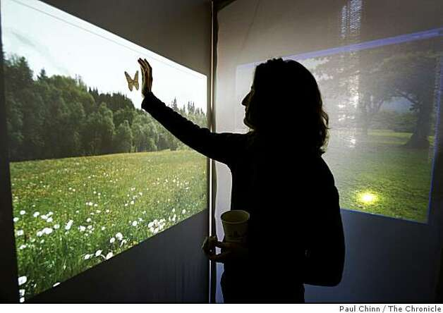 Shawna Hein tries to catch a virtual butterfly in a simulated elevator, one of the projects demonstrated by students in the Theory and Practice of Tangible User Interfaces class at Cal's School of Information in Berkeley, Calif., on Tuesday, Dec. 9, 2008. Photo: Paul Chinn, The Chronicle