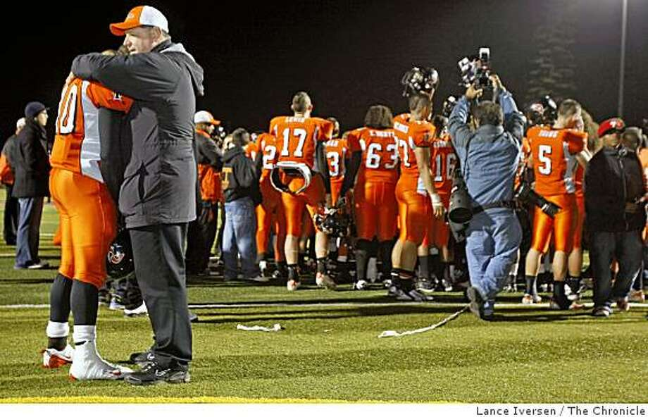 Pittsburg defensive coach Jim Shipe right hugs his linebacker Emeka Williams at the end of the game. De La Salle defeated Pittsburg High 34-10 for the North Coast Division 1 Championship Friday Dec 12, 2008. Photo: Lance Iversen, The Chronicle