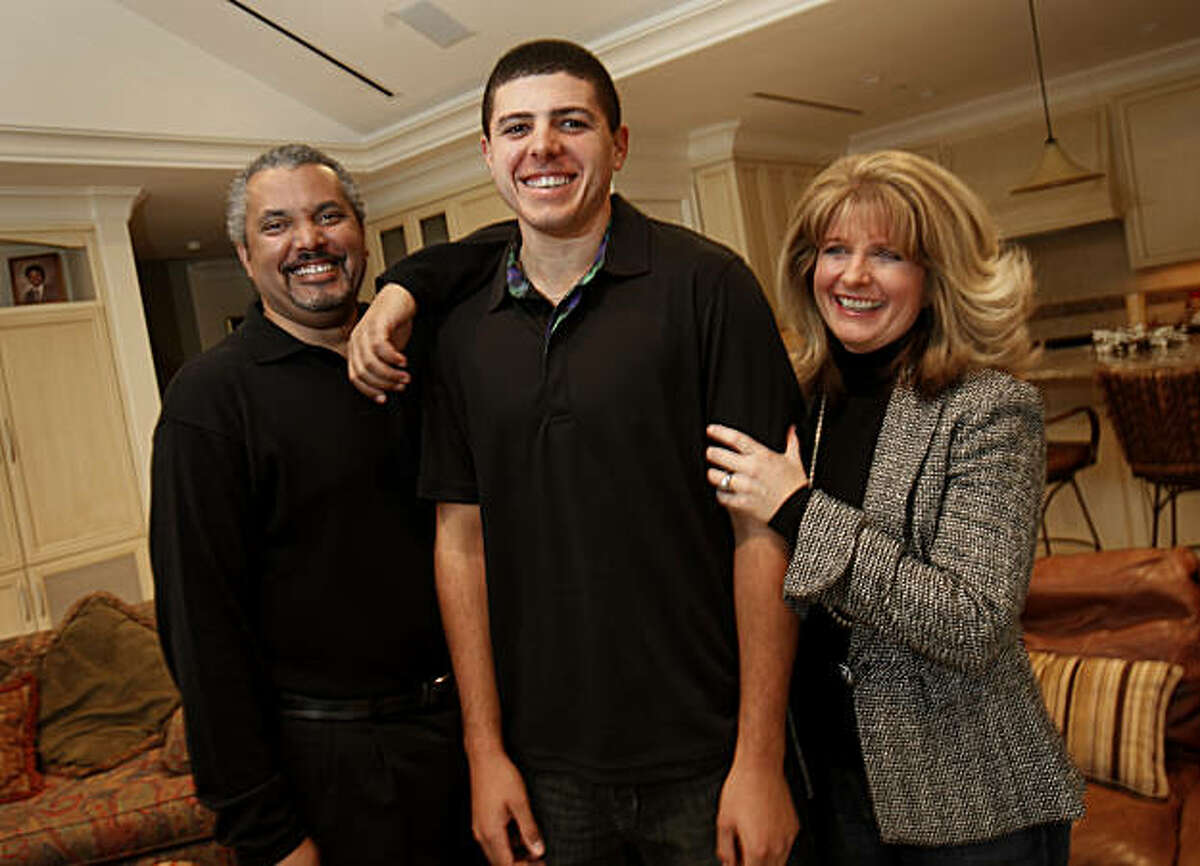 Joseph Bramlett, (center) smiles as he stands with his father Marlo and mother Debbie in their home Monday January 3, 2011. Joseph Bramlett, from Saratoga, Calif., is the rare golfer with African American heritage who will join the PGA Tour this year after finishing at Stanford.