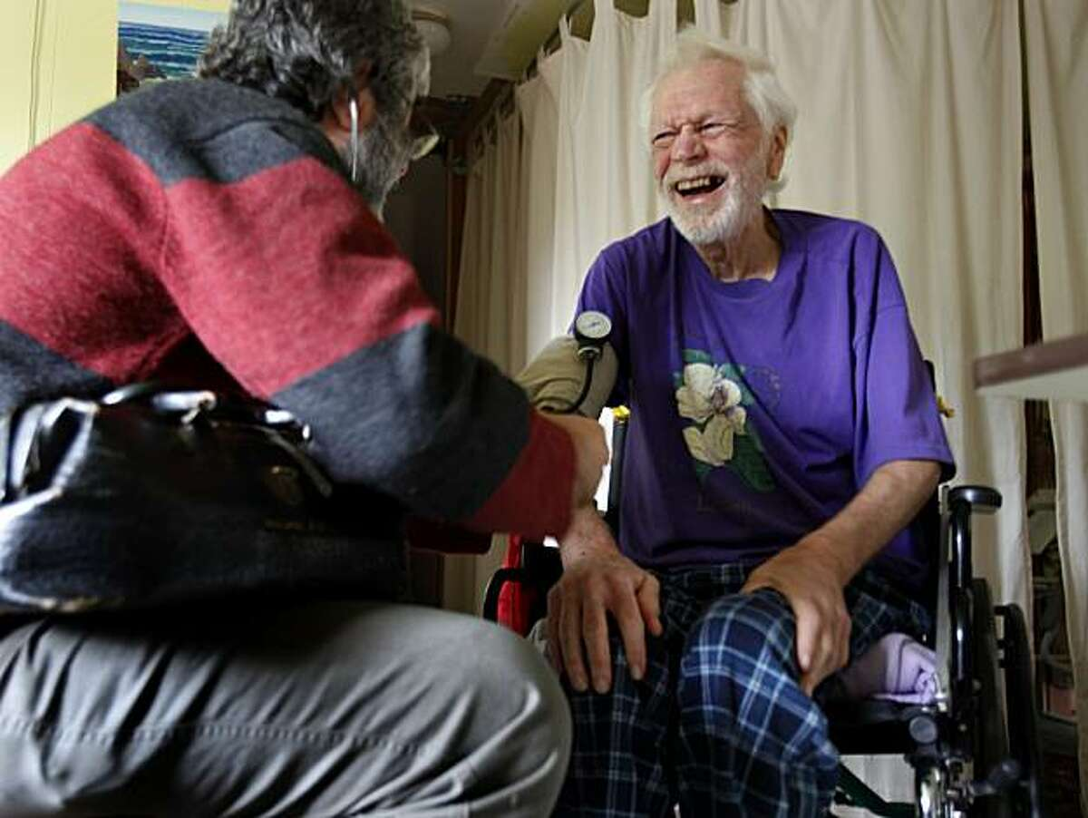 Patient John Lewallen (right) laughs as Dr. Mark Apfel checks his blood pressure during a house call Tuesday December 21, 2010. Aging doctors in Mendocino County, Calif., are finding it difficult to consider retirement because there are so few replacements. Younger doctors coming out of medical school are choosing more lucrative urban settings for their medical practices.