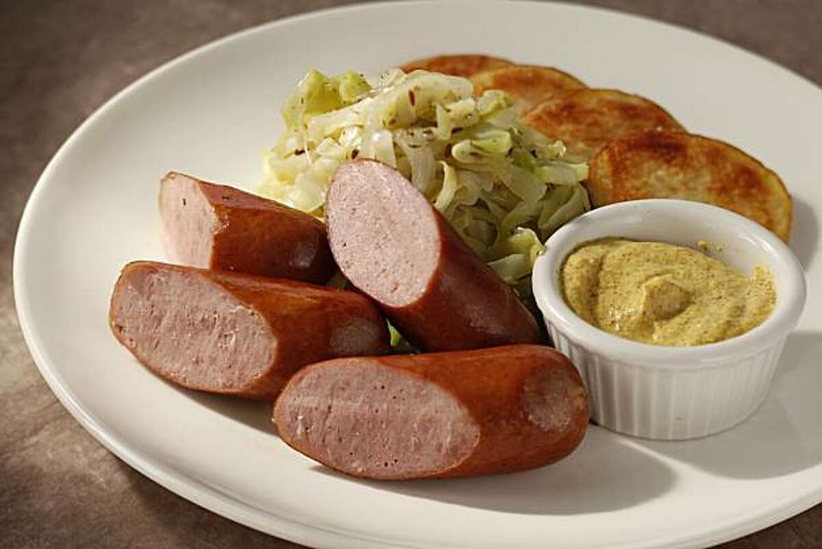Sausage and sauteed cabbage as seen in San Francisco, Calif., on December 21, 2010. Food styled by Kelly Rae Hickman.