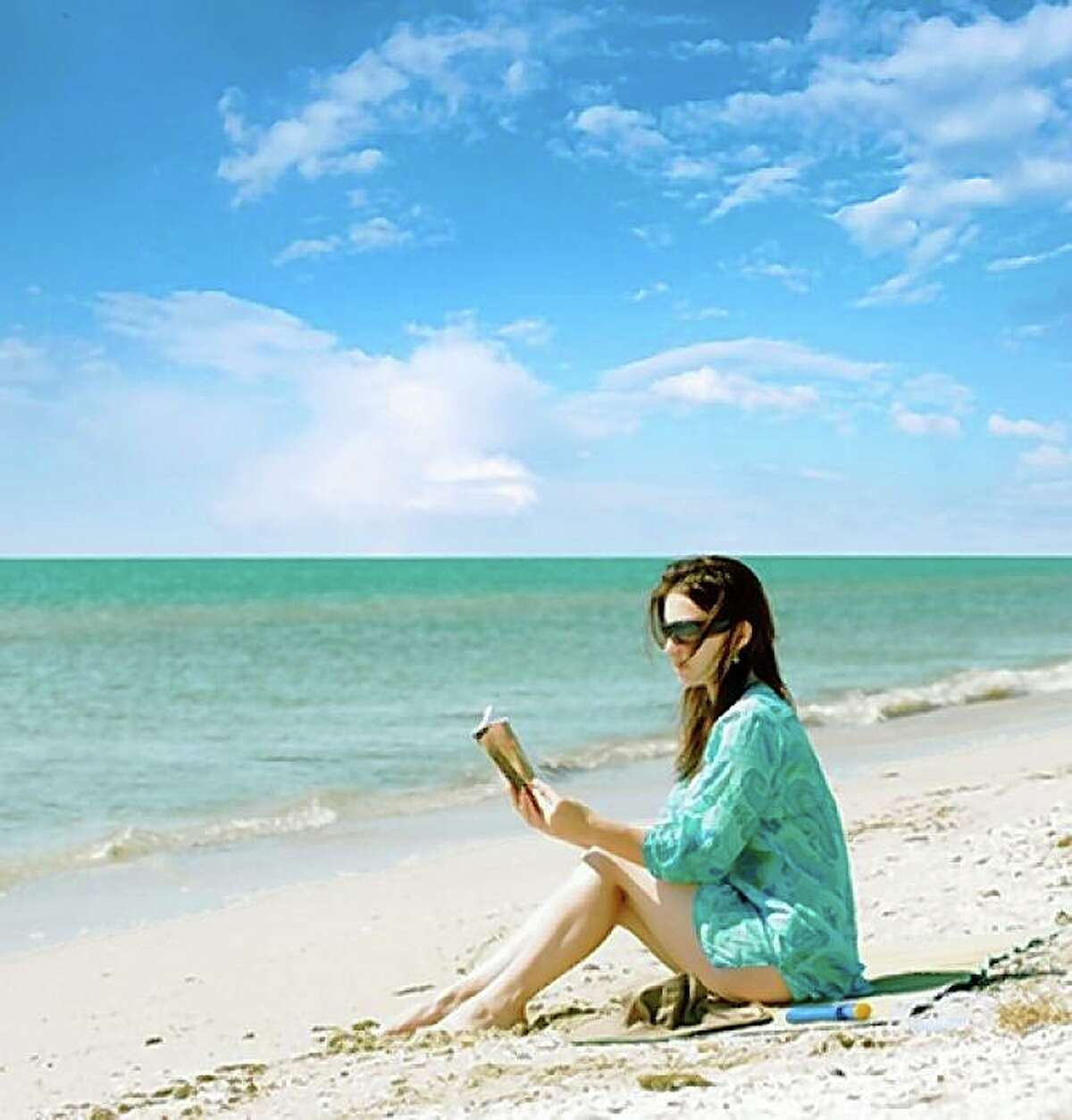 Woman reading on the beach.