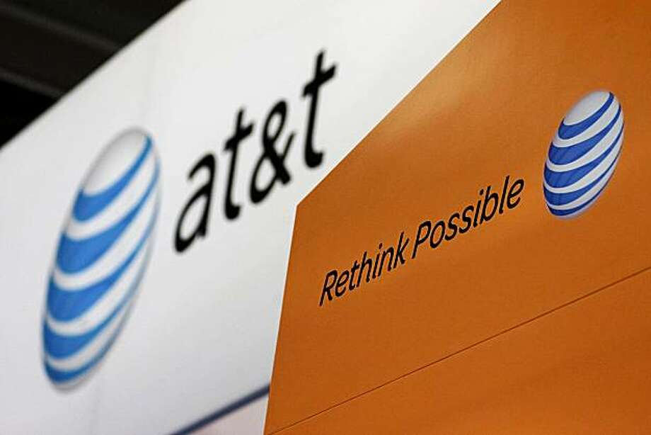 The At&T Inc. logo is displayed during the CTIA Enterprise & Applications conference at the Moscone Center in San Francisco, California, U.S., on Thursday, Oct. 7, 2010. The number of smartphone owners in the U.S., the biggest market for the mobile devices, rose 11 percent to 53.4 million in the quarter ended July, accounting for 23 percent of global shipments. Photographer: David Paul Morris/Bloomberg Photo: David Paul Morris, Bloomberg News