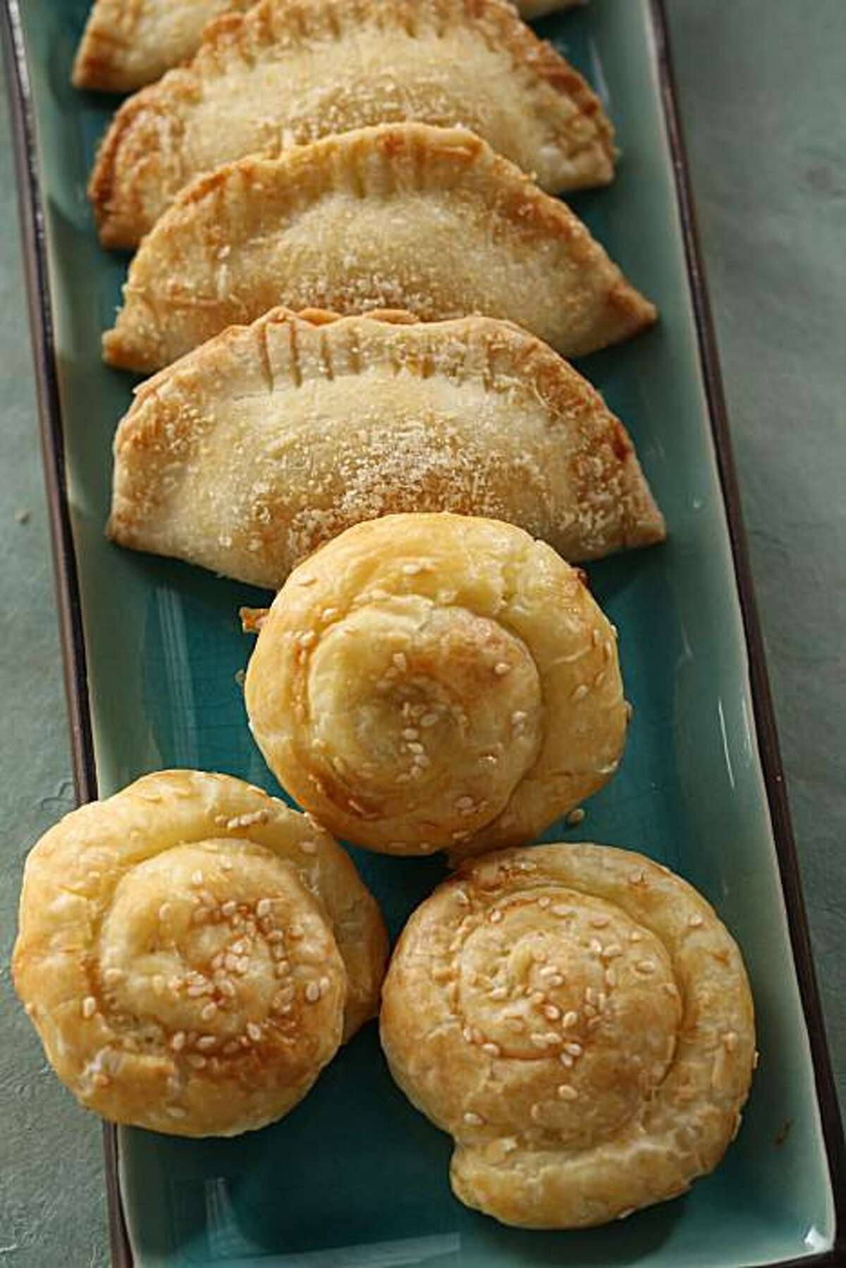 Borekas and bollos (round), traditional Sephardic pastries for Rosh Hashanah (Jewish New Year) in San Francisco, Calif., on September 18, 2008. Food styled by Emma Sullivan.