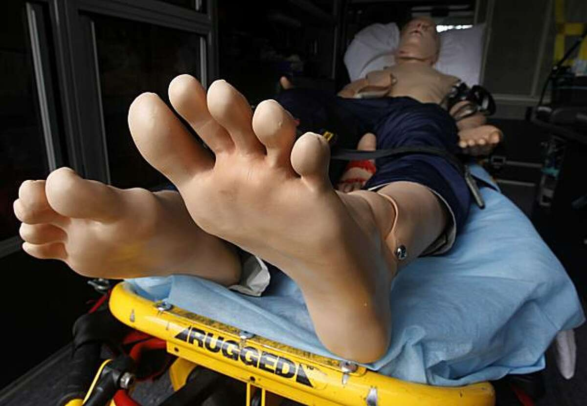 What a Dummy - 11:06 a.m. - Menlo Park. I did a double take when I walked by an open ambulance and noticed the cleanest pair of feet that I've ever seen. It was only then that I realized it was a life-sized dummy strapped to a gurney that was on display at a disaster preparedness exhibition. Camera settings: Canon EOS-1D MkIV, ISO 200, 1/20, f13, 16mm.
