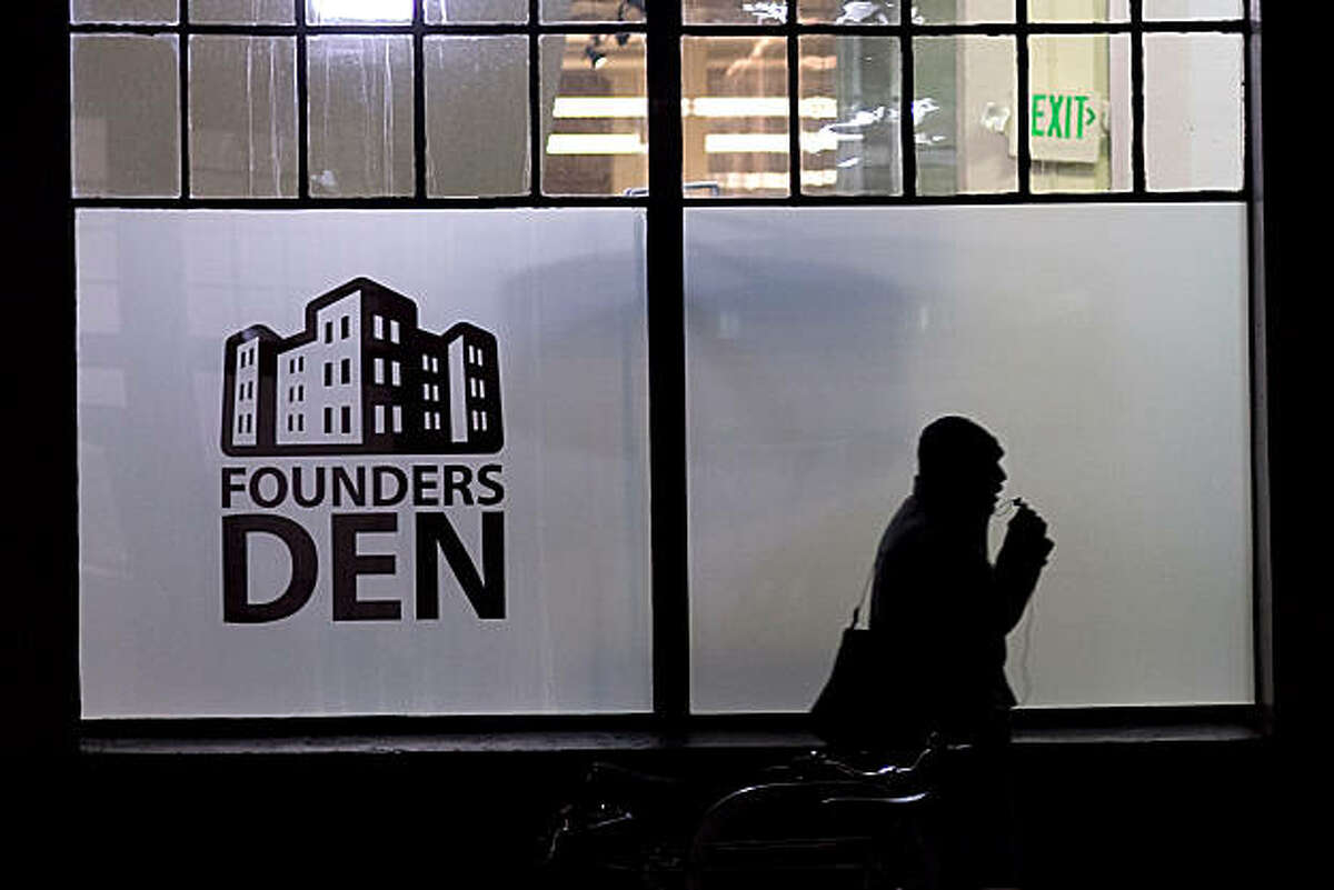 A man walks past the front of the Founders Den on January 7, 2011 in San Francisco, Calif. Photograph by David Paul Morris/Special to the Chronicle