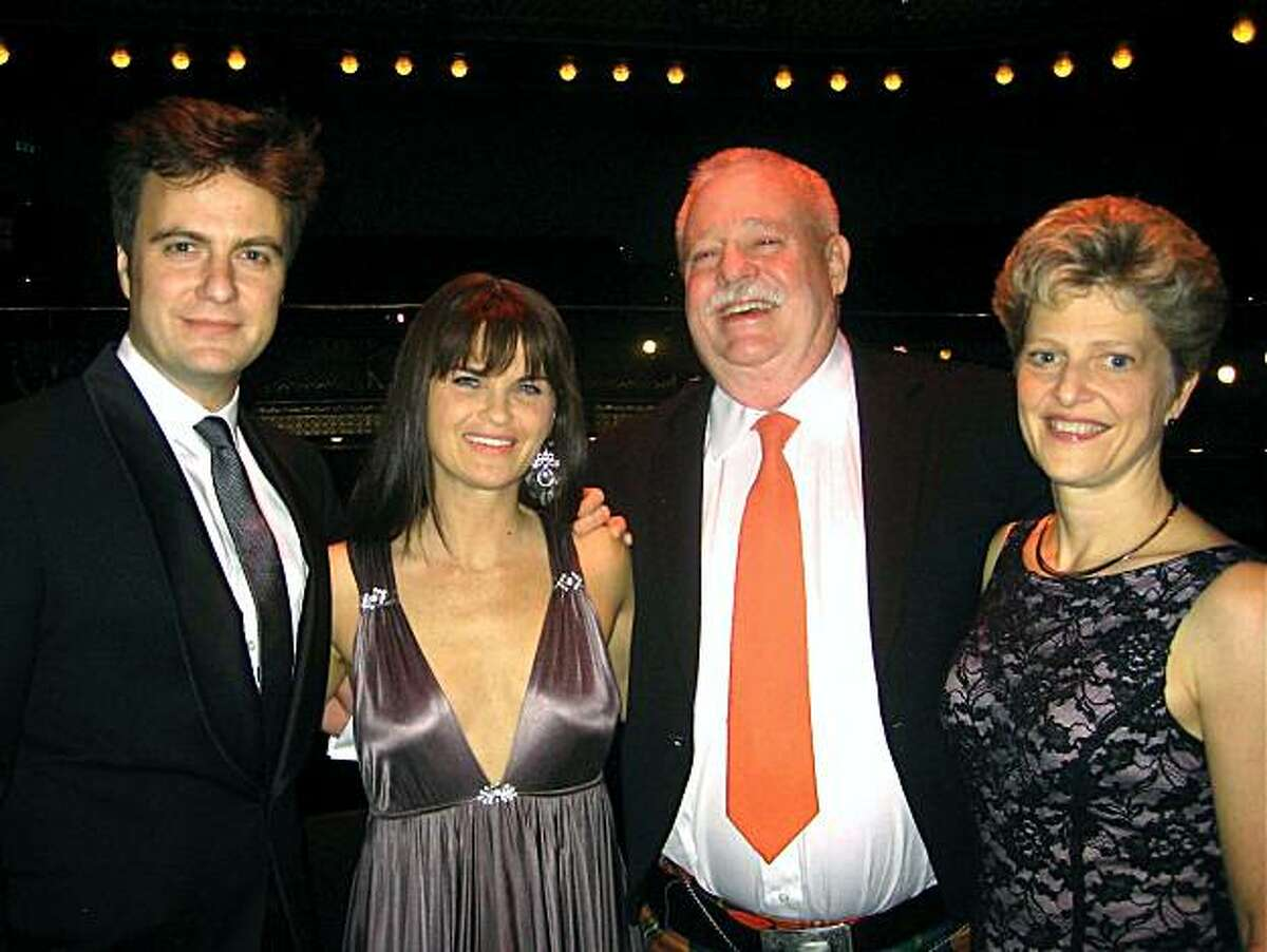 ACT artists Manoel Feliciano and Mary Birdsong (at left) with Armistead Maupin and Carey Perloff at ACT Producer Circle Dinner. Jan 2011. By Catherine Bigelow.
