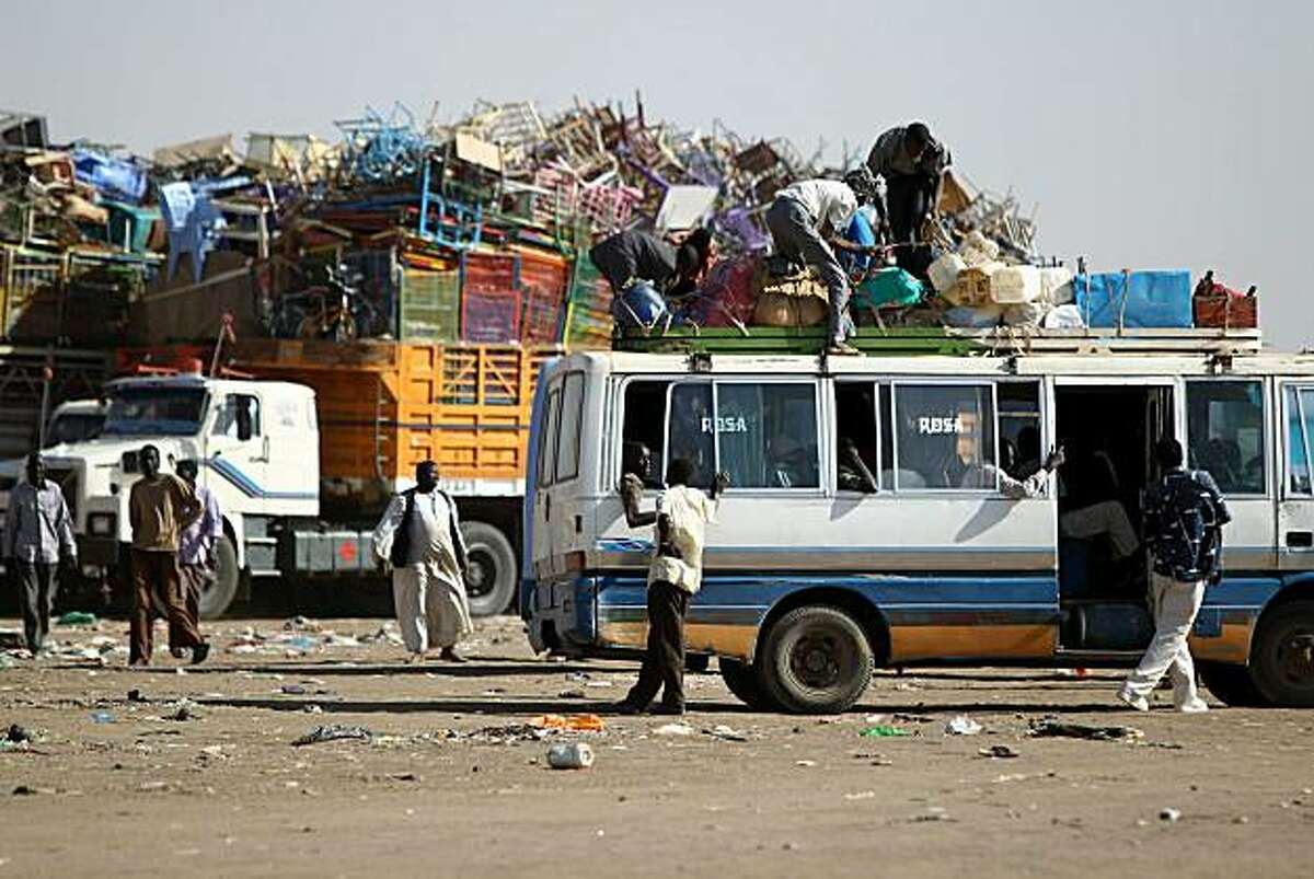 Southern Sudanese families load their belongings on buses in Mandela area in the outskirts of the capital of Khartoum on January 6, 2011 before returning to their homeland from the north ahead of a key referendum on south Sudan's independence.