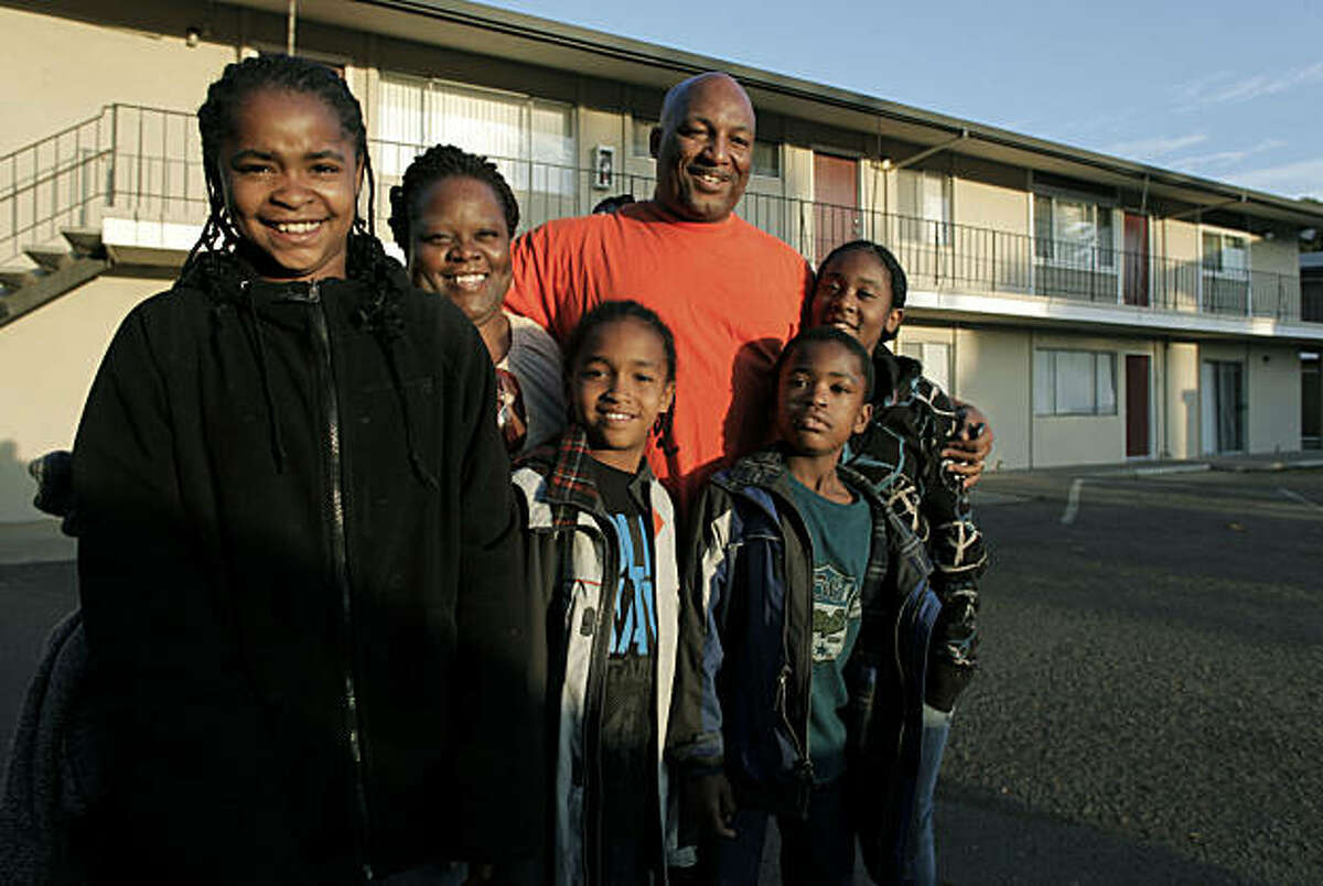 (left to right) Dominique Carter,13, Prima Williams, Isaiah Santiago,9, Michael Davis, Jordan Carter,7 and Deja Mack, 13, the family together, on Thursday Nov. 18, 2010, which has grown since Michael and Prima are now caring for Michael's two neices a(left to right) Dominique Carter,13, Prima Williams, Isaiah Santiago,9, Michael Davis, Jordan Carter,7 and Deja Mack, 13, the family together, on Thursday Nov. 18, 2010, which has grown since Michael and Prima are now caring for Michael's two neices and a nephew in their San Leandro, Ca. home.