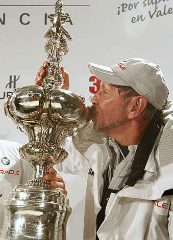 BMW Oracle Racing owner Larry Ellison poses kissing the America's Cup trophy after winning the 33rd edition of the sailing classic against Alinghi in Valencia, Spain, on Sunday, Feb. 14, 2010. Photo: Alberto Saiz, AP