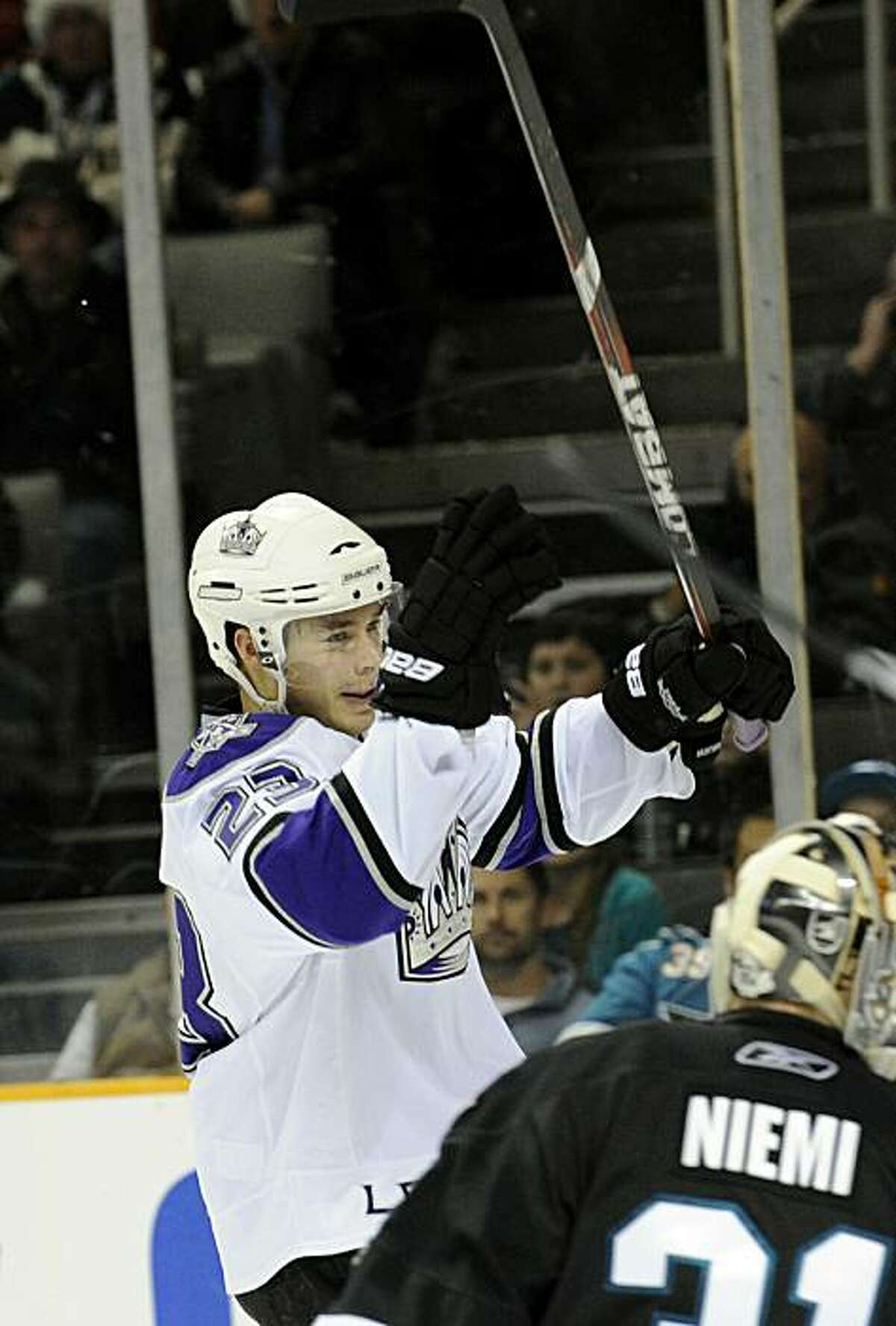 SAN JOSE, CA - DECEMBER 27: Dustin Brown #23 of the Los Angeles Kings celebrates after scoring a goal against the San Jose Sharks during an NHL hockey game at the HP Pavilion on December 27, 2010 in San Jose, California. The Kings won the game 4-0.