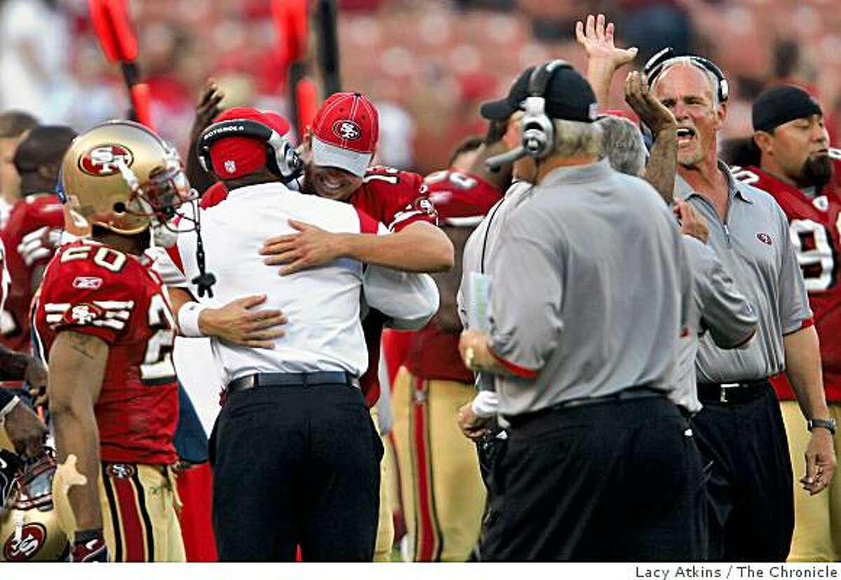 San Francisco 49ers head coach Mike Singletary hugs quarterback Shaun Hill after defeating the St. Louis Rams, Sunday Nov. 16, 2008, in SanFrancisco , Calif.