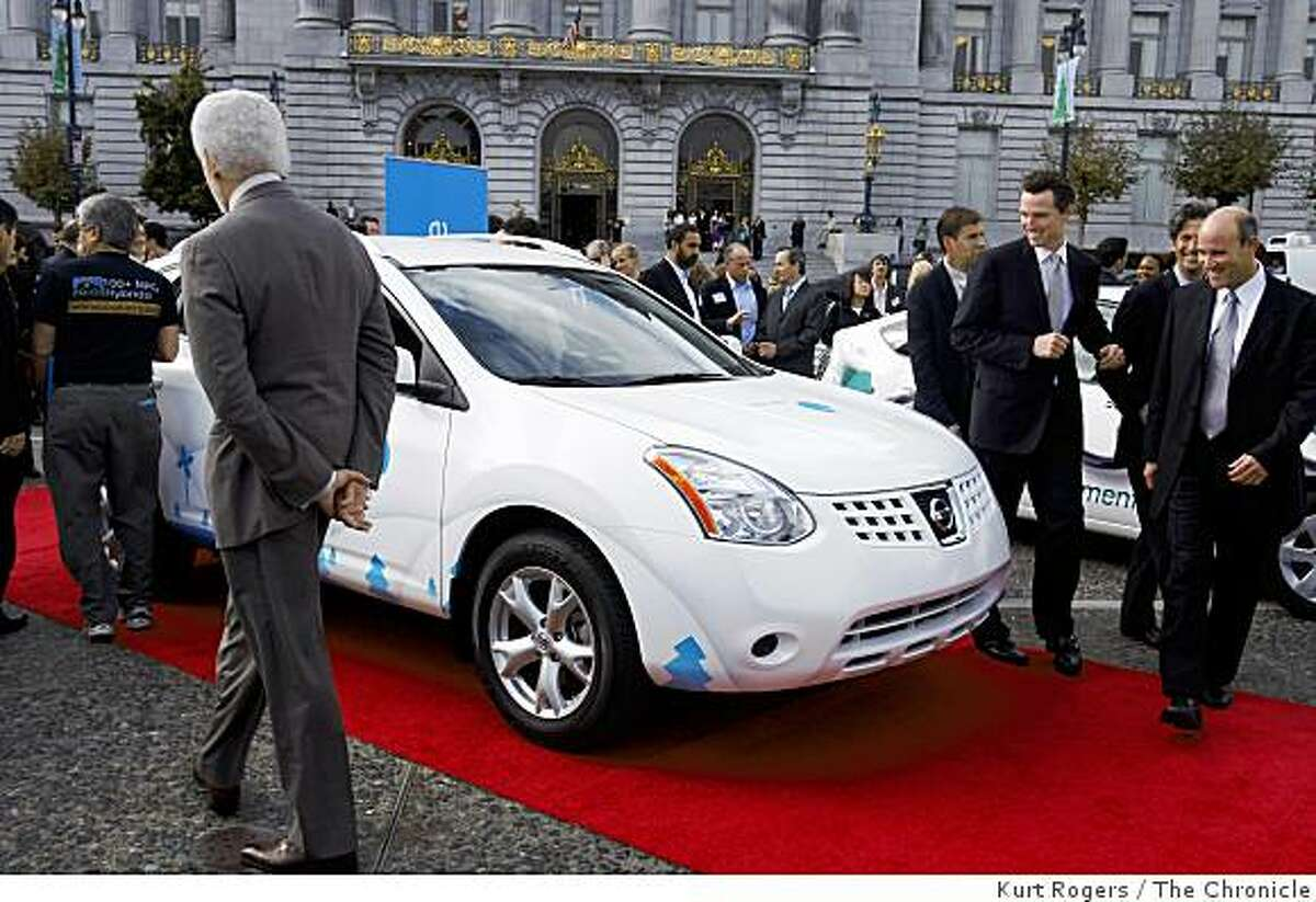 Oakland Mayor Ron Dellums (left) and Mayor Gavin Newsom look at an electric car on Nov. 20, 2008 in San Francisco, Calif., after announcing that the Bay Area will build an electric vehicle network with a $1 billion private investment in infrastructure and initiatives aimed at making them more affordable.