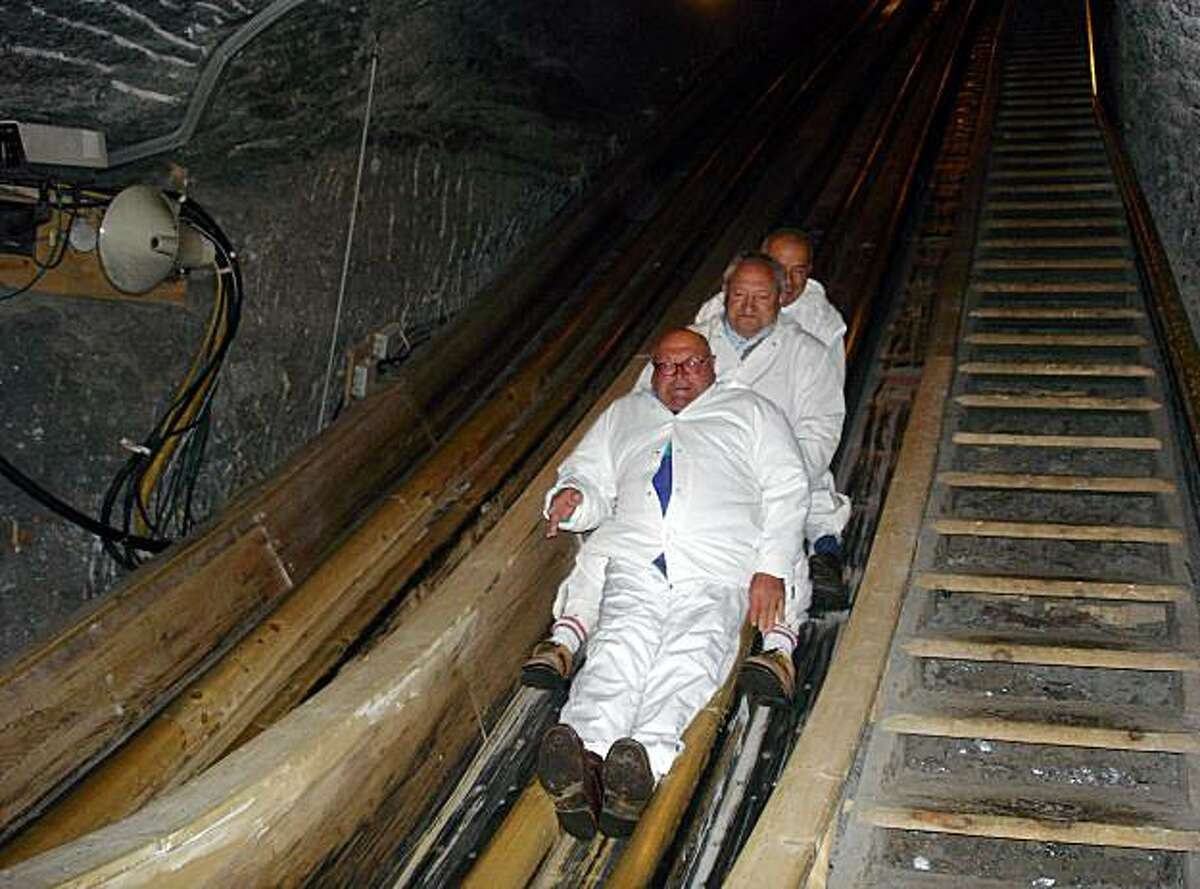 Visitors to Hallstatt's salt mine slide down two banisters. At the end, they find out their time and receive an automatic souvenir photo.
