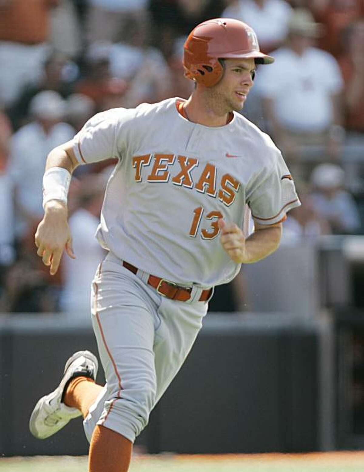 Texas' Brandon Belt runs to first base after hitting an eighth-inning single that drove in a run against TCU in the NCAA college baseball super regionals in Austin, Texas, Sunday, June 7, 2009. TCU won 3-2 to force a third game in the series. (AP Photo/Chris Carson)