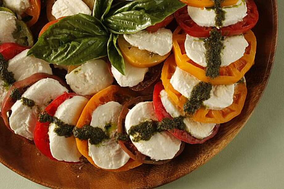 Caprese Salad With Basil Puree: The made-for-each-other flavors in this classic salad are hard to improve upon as long as you have terrific tomatoes. Click here for the recipe.  Photo: Craig Lee, Special To The Chronicle