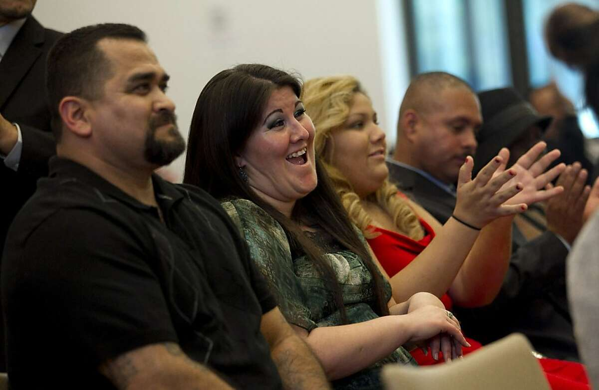 Melissa Pirraglio, second from left, laughs during the graduation ceremony of the Los Angeles Violence Intervention Training Academy (LAVITA) in Los Angeles, Tuesday, Dec. 20, 2011. Pirraglio spent many of her 11 years of gang life in drug-addled despair seeking a way out.