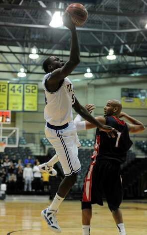 St. Mary's Isaiah Matthews (54) makes an off balanced shot during a Heartland Conference Men's Basketball game between St. Mary's University and Dallas Baptist at Bill Greehey Arena In San Antonio, Texas on January 9, 2012. John Albright / Special to the Express-News. Photo: Express-News