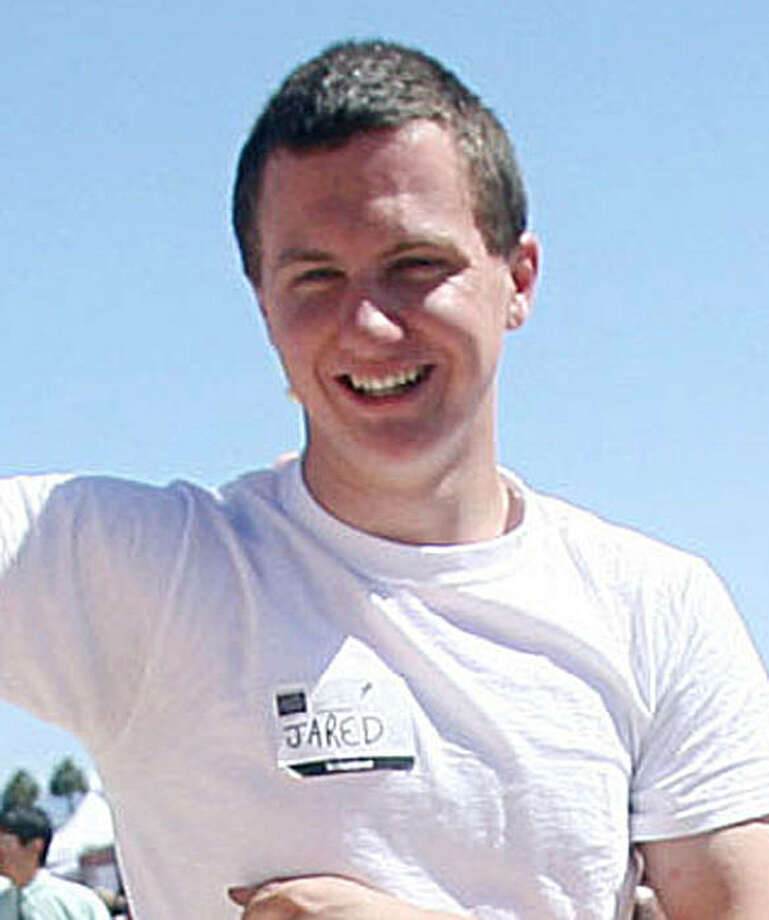 This March 2010 photo shows a man identified as Jared L. Loughner at the 2010 Tucson Festival of Books in Tucson, Ariz. The Arizona Daily Star, a festival sponsor, confirmed from their records that the subject's address matches one under investigation by police after a shooting in Tucson that left U.S. Rep. Gabrielle Giffords wounded and at least five others dead. Police say a suspect is in custody, and he was identified by people familiar with the investigation as Jared Loughner, 22, of Tucson.    (AP Photo/Arizona Daily Star, Mamta Popat) NO MAGS, NO SALES, MANDATORY CREDIT Photo: Mamta Popat, AP