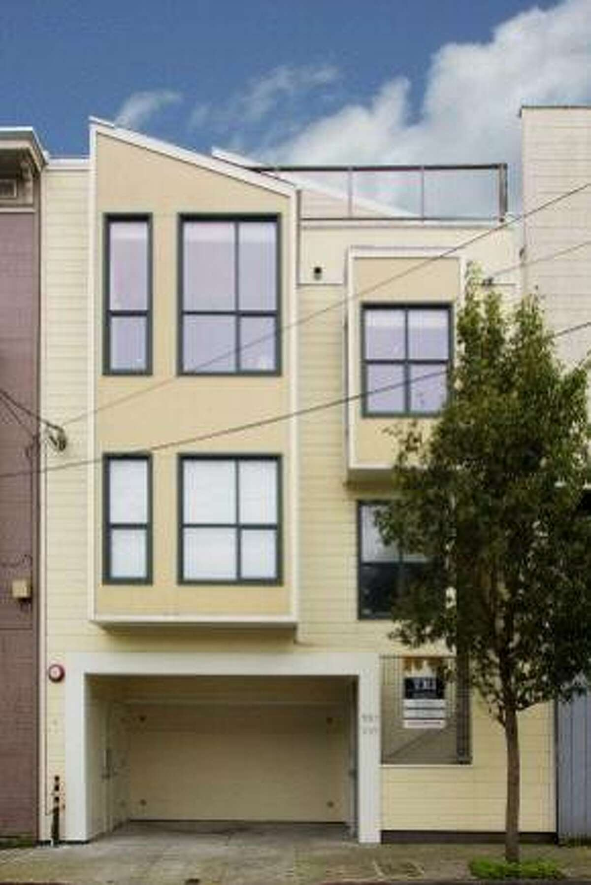 The top-floor condo at 557 Birch St. in Hayes Valley was built in 2001 and includes three bedrooms and three bathrooms. The modern property is listed for $1.049 million.