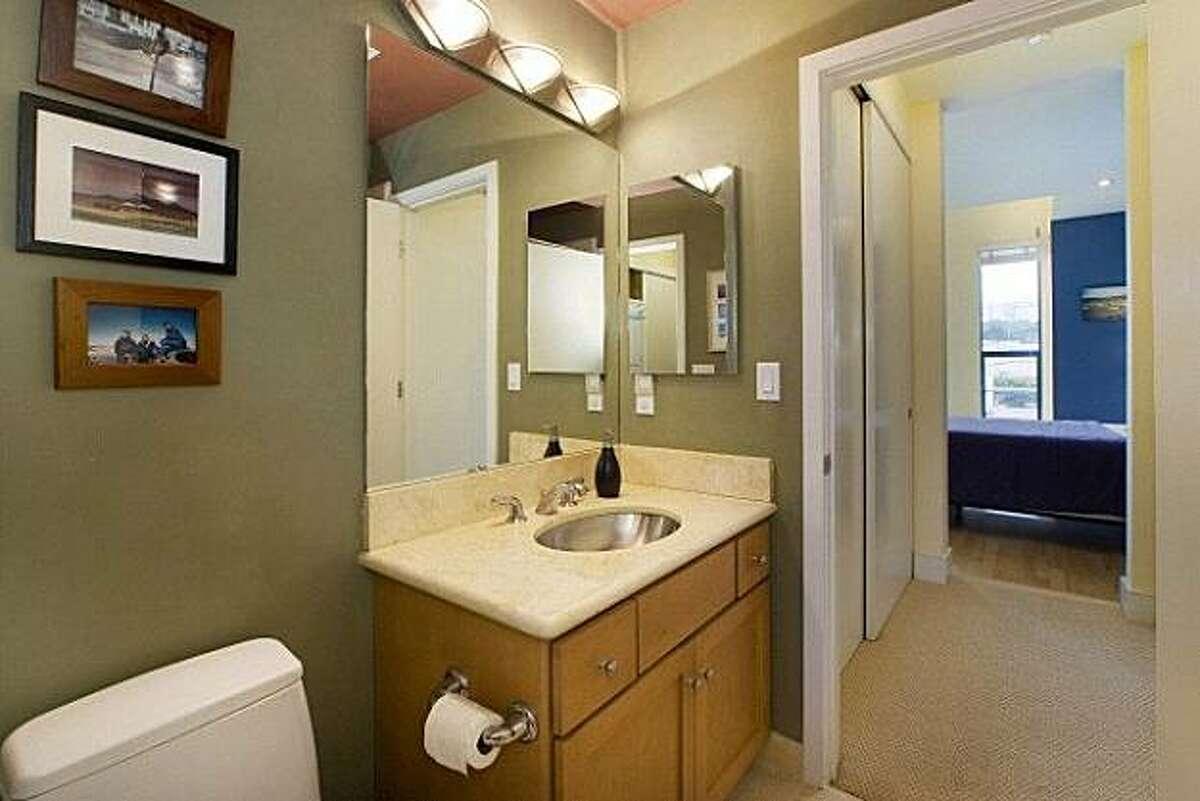 The 1,635-square-foot condo has three full bathrooms.
