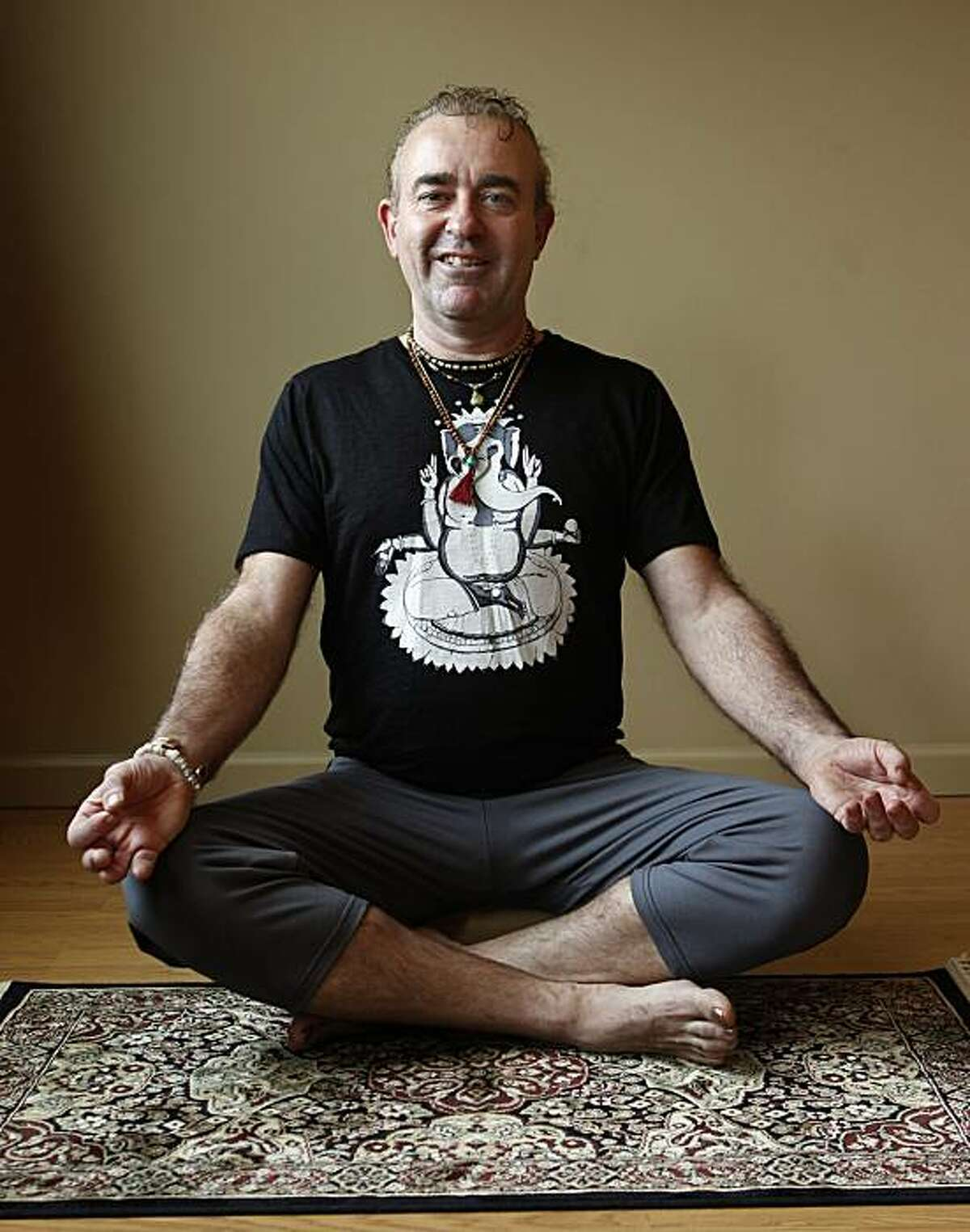 Tim Dale, founder of the Yoga Tree studio, strikes a yoga pose in San Francisco, Calif., on Friday, Dec. 10, 2010.
