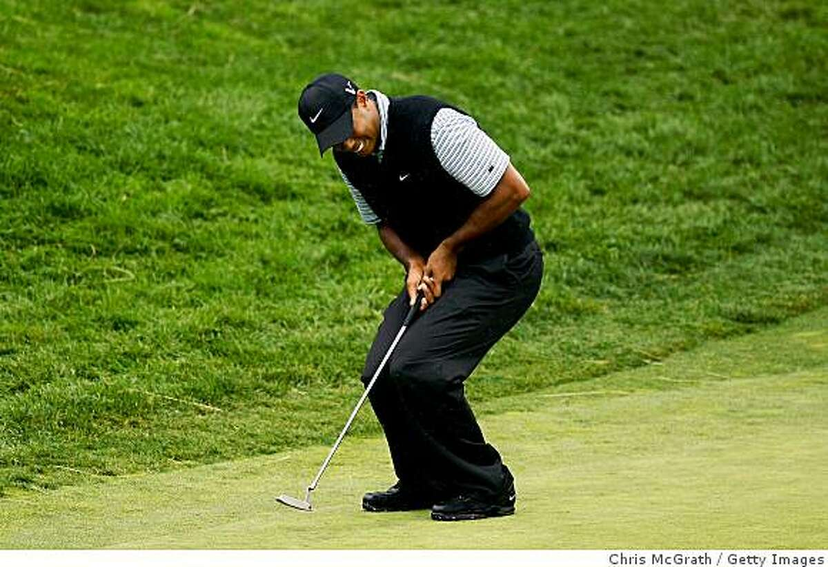 FARMINGDALE, NY - JUNE 20: Tiger Woods reacts to missing a putt on the eigth hole during the continuation of the second round of the 109th U.S. Open on the Black Course at Bethpage State Park on June 20, 2009 in Farmingdale, New York. (Photo by Chris McGrath/Getty Images)