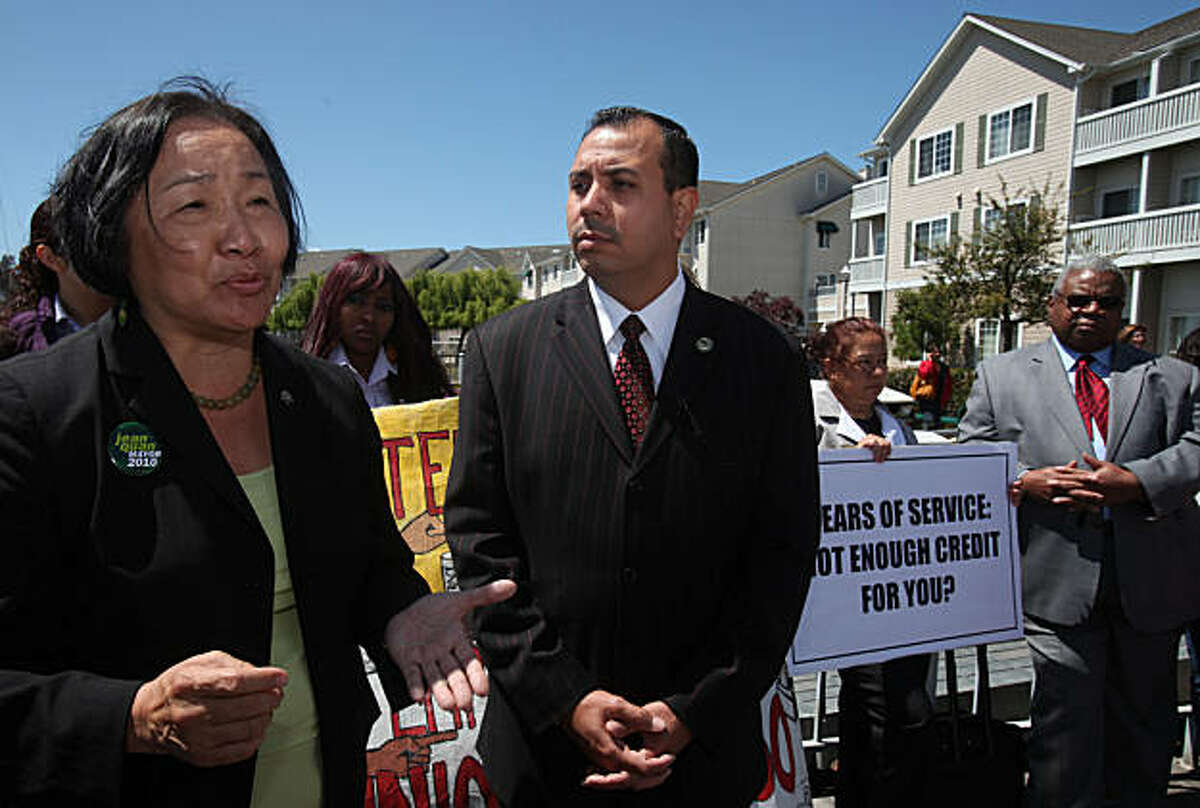 Oakland councilwoman Jean Quan (left) and assemblymember Tony Mendoza (middle,D-Norwalk) supporting employees as they protest at Oakland Homewood Suites in Oakland, Calif., on Thursday, April 29, 2010. Employees at the Oakland Homewood Suites must reapply for their jobs as it undergoes new management, and must have a credit check, which they feel would hurt chances of being rehired.