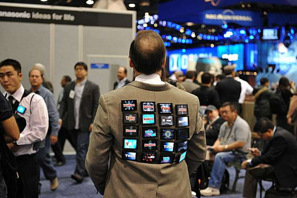 Robert Norden, President and CEO of Recom Group, wears video name tags on his back as he attends at the 2010 International Consumer Electronics Show on January 7, 2010 in Las Vegas, Nevada. CES, the world's largest annual consumer technology tradeshow, runs from January 7-10.